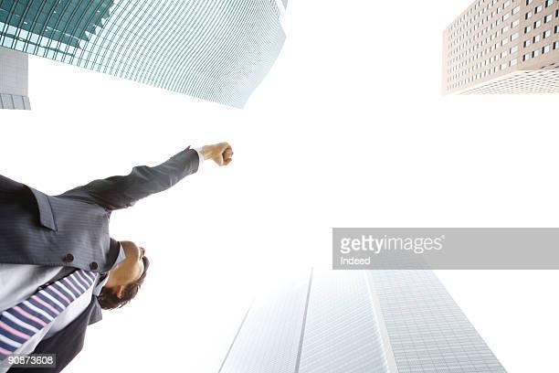 Businessman raising hand to the sky