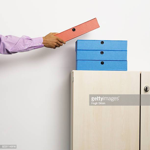 businessman reaching for file - hugh sitton stock pictures, royalty-free photos & images