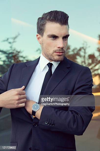 Businessman reaching into his pocket