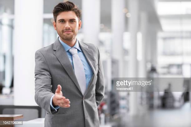businessman reaching out his hand - stock trader stock pictures, royalty-free photos & images