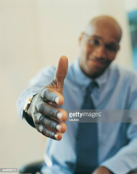 Businessman Reaching out to Shake Hand