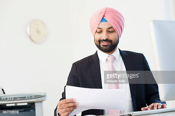 Businessman reading a document and smiling