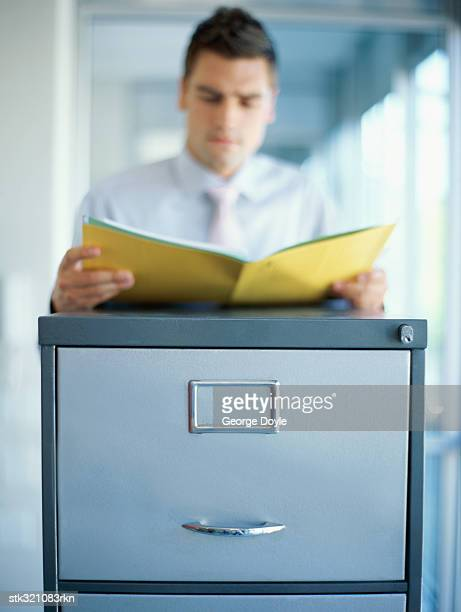 businessman reading a file in an office