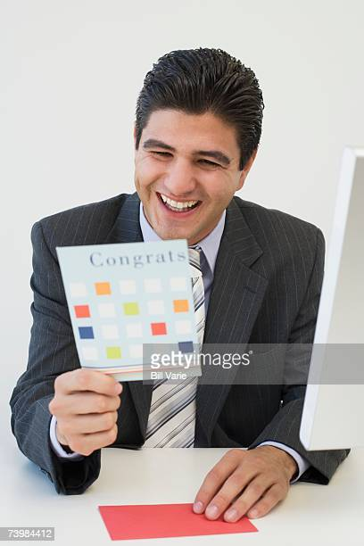 Businessman reading a greeting card