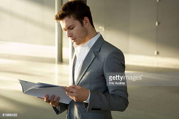 Businessman reading a magazine