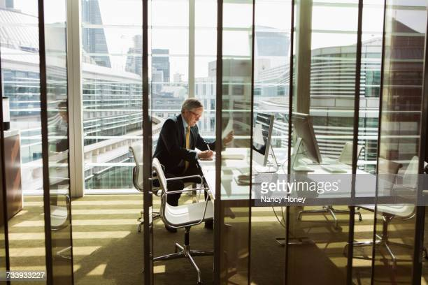 businessman reading and analysing report, london, uk - law office stock photos and pictures