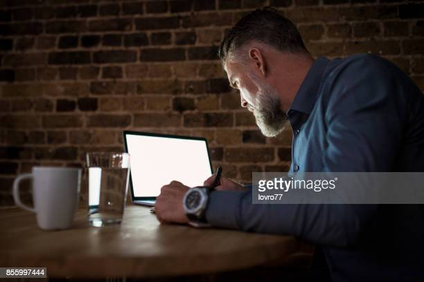 Businessman reading and editing own notes