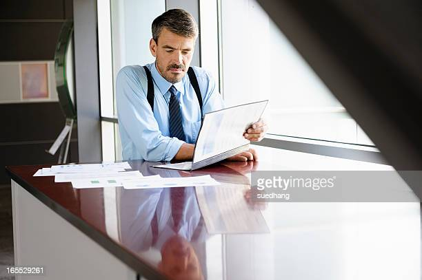 businessman reading at desk - suspenders stock pictures, royalty-free photos & images