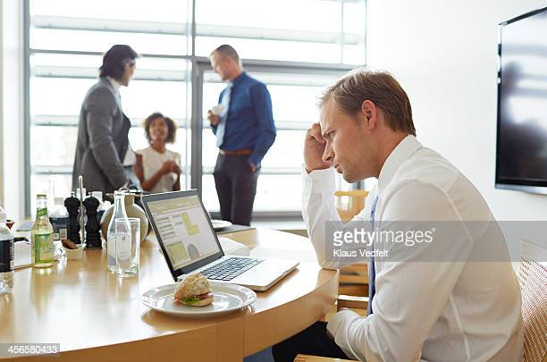 Businessman Reading bad news on his laptop