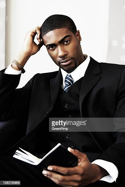businessman reading book - most handsome black men stock photos and pictures