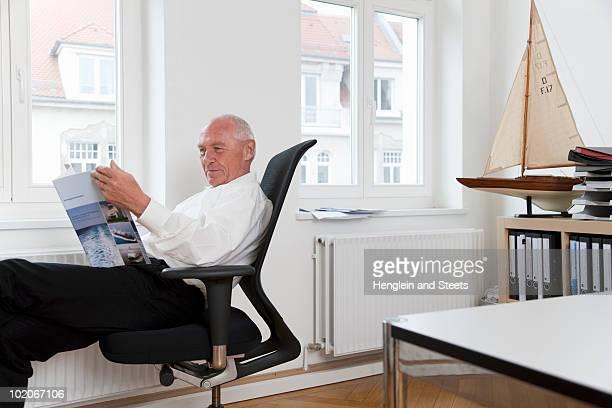 Businessman reading brochure