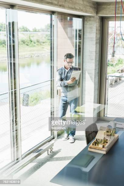 Businessman reading documents in an office