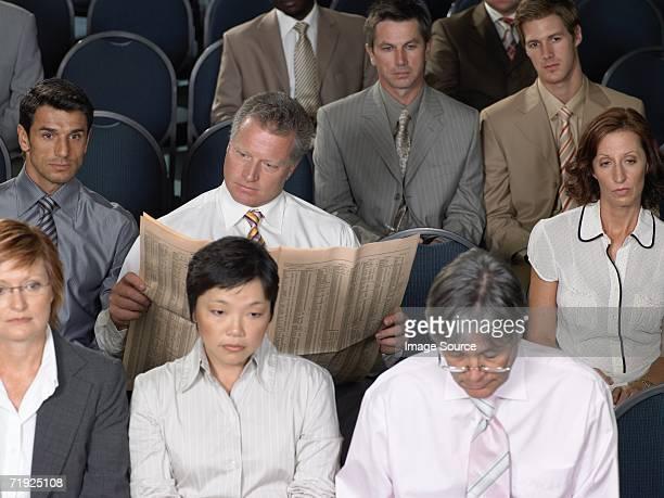 Businessman reading during presentation