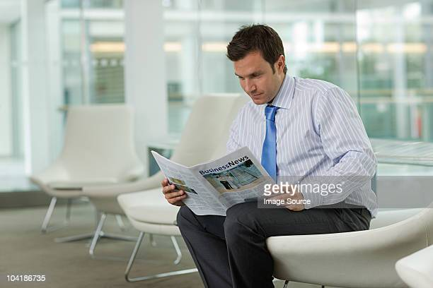 Businessman reading magazine