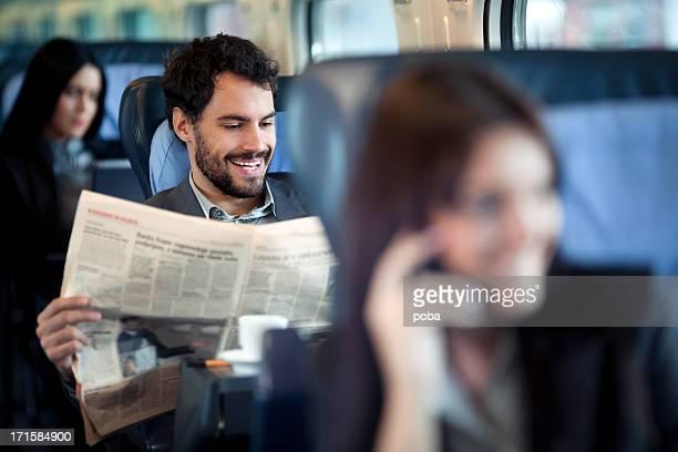 Businessman reading  Newspaper  on a Train