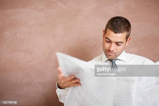 businessman reading newspaper - front page stock photos and pictures