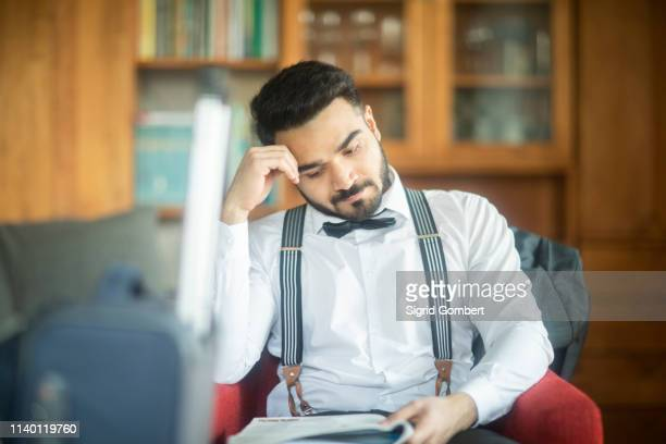 businessman reading report - sigrid gombert stock pictures, royalty-free photos & images