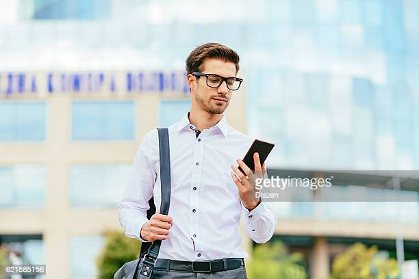 businessman reading text message on smartphone - drazen stock pictures, royalty-free photos & images