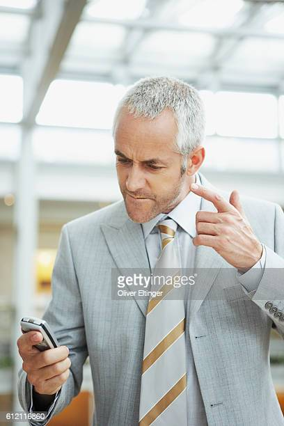 Businessman reading text message