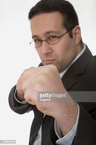 Businessman ready to fight, his fists balled