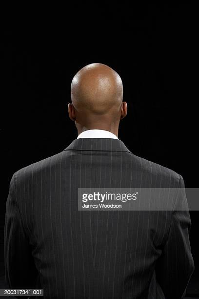 businessman, rear view - completely bald stock pictures, royalty-free photos & images