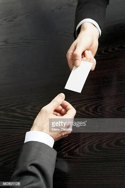 Businessman receiving business card