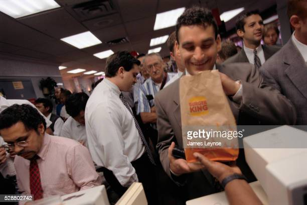 businessman receiving his burger king lunch order - burger king stock pictures, royalty-free photos & images