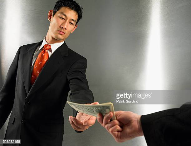 Businessman Receiving Money