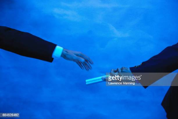 Businessman Receiving Relay Baton