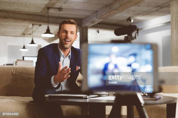 businessman recording a video for this vlog - influencer stock pictures, royalty-free photos & images