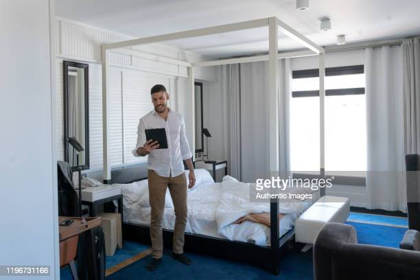 businessman rehearsing a presentation on his digital tablet in his hotel room - practicing stock pictures, royalty-free photos & images