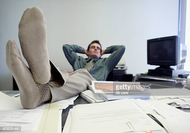 businessman relaxing at desk with feet up - men in white socks fotografías e imágenes de stock