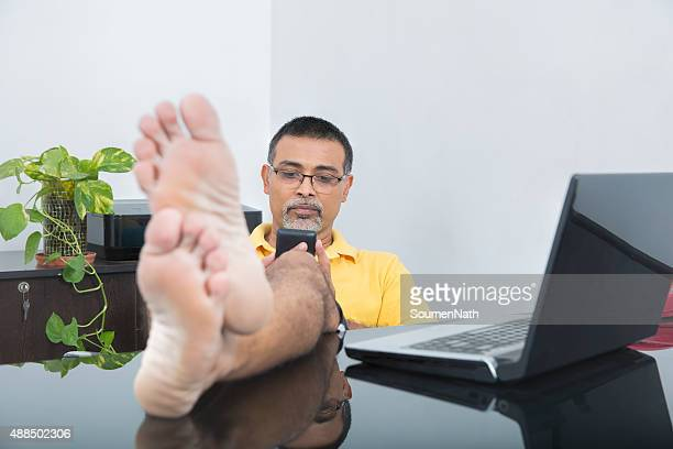 Businessman relaxing in his home office wearing casual dress