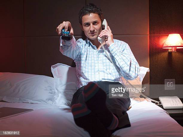 Businessman relaxing in hotel room