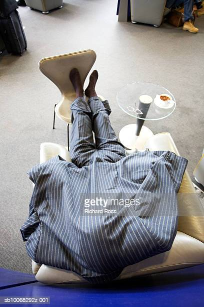 Businessman relaxing on armchair