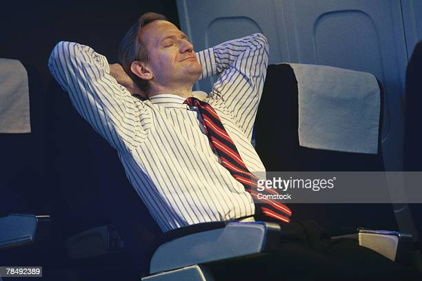 Businessman relaxing on flight
