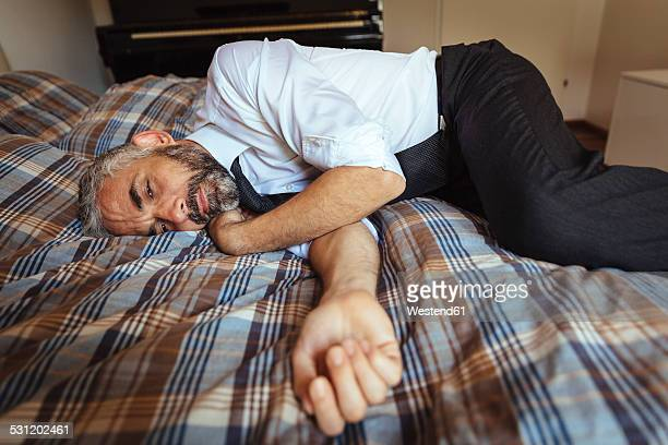 Businessman relaxing on his bed