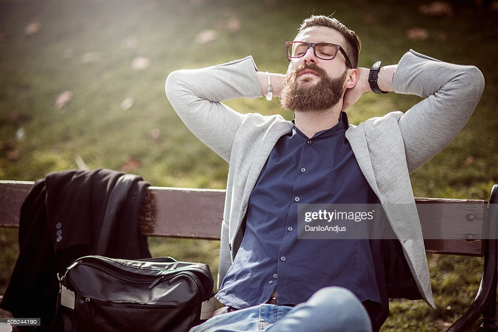 businessman relaxing on the bench after work : Stock Photo