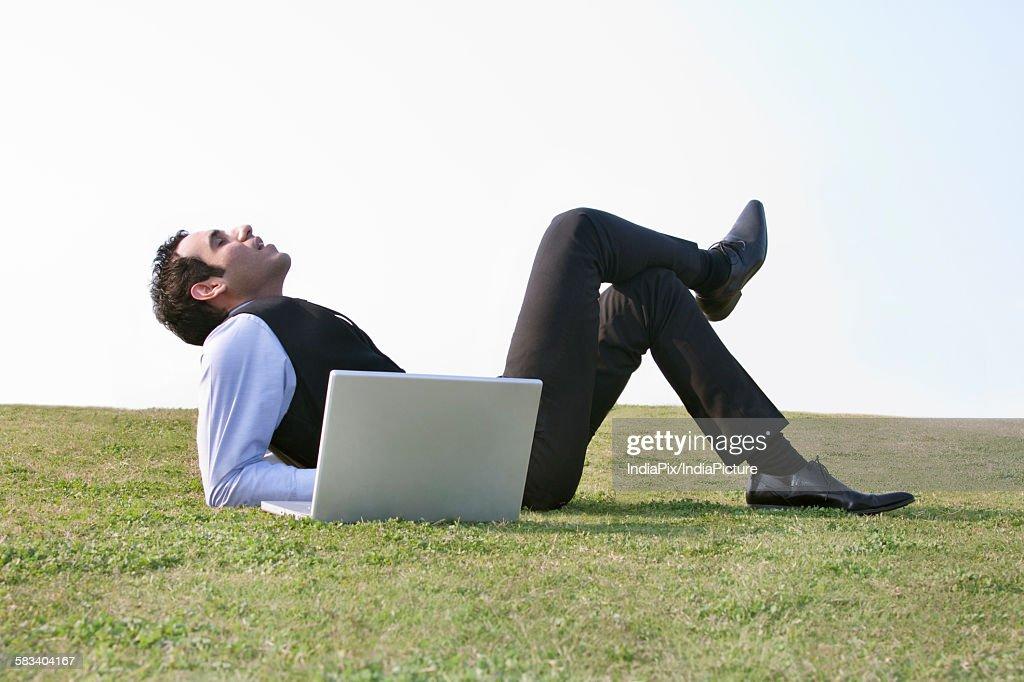Businessman relaxing outdoors , INDIA , DELHI : Stock Photo