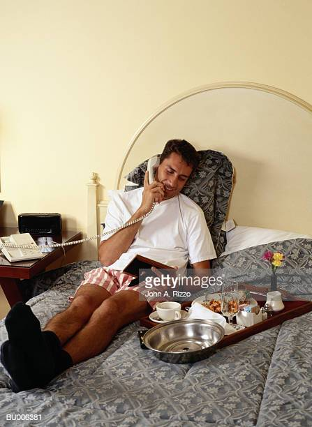 Businessman Resting in Hotel Room