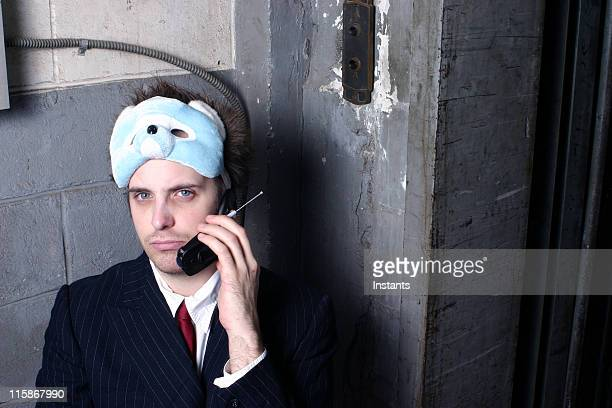 Businessman Resting Mask on Top of Head