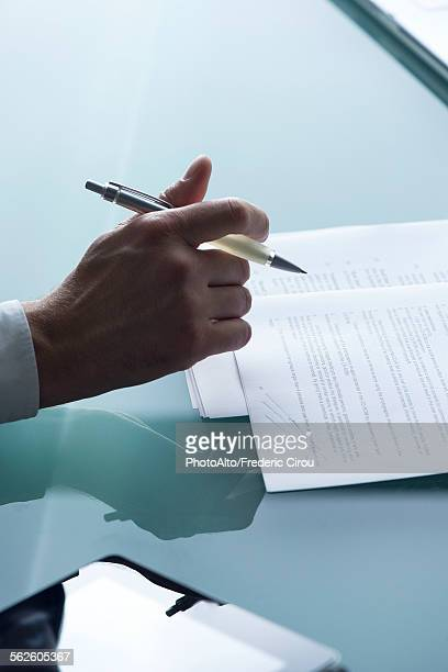 businessman reviewing document, cropped - permission concept stock pictures, royalty-free photos & images