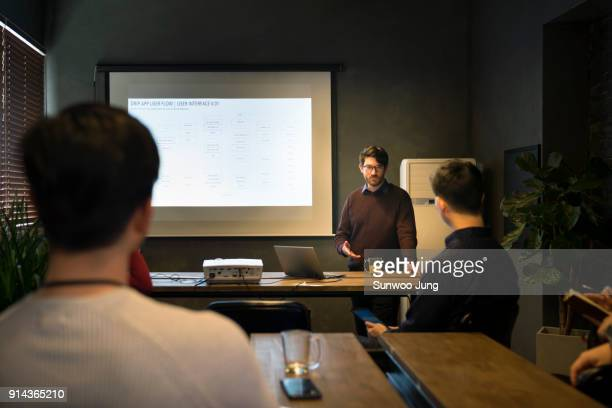Businessman reviewing project during presentation in office