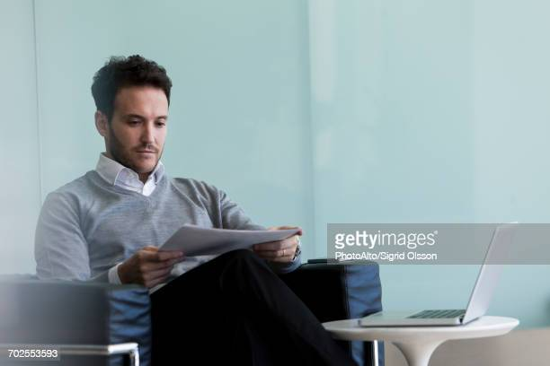 businessman reviewing report - mission statement stock photos and pictures