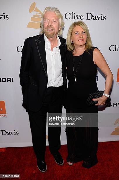 Businessman Richard Branson and Joan Templeman attend the 2016 Pre-GRAMMY Gala and Salute to Industry Icons honoring Irving Azoff at The Beverly...