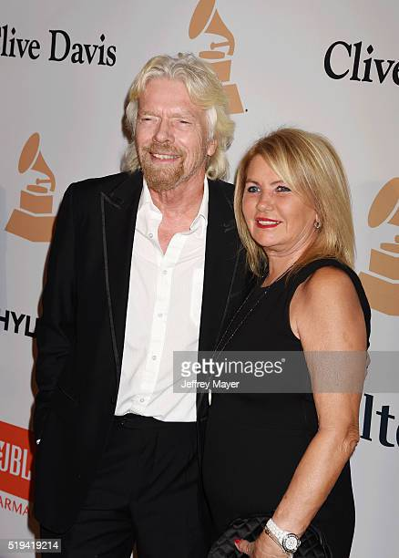 Businessman Richard Branson and Joan Templeman attend the 2016 PreGRAMMY Gala and Salute to Industry Icons honoring Irving Azoff at The Beverly...