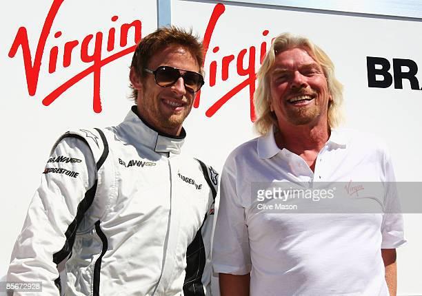 Businessman Richard Branson meets Brawn GP driver Jenson Button of Great Britain as his Virgin company announces taking out sponsorship on the Brawn...
