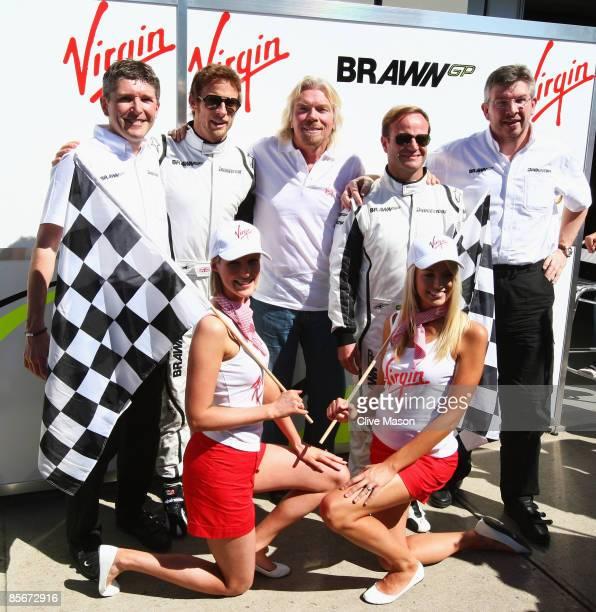 Businessman Richard Branson meets Brawn GP drivers Jenson Button of Great Britain Rubens Barrichello of Brazil Brawn GP Team Principal Ross Brawn and...