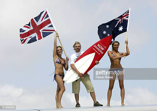 Businessman Richard Branson stands on the wing of a Virgin Atlantic aircraft on his arrival to launch his new Virgin Atlantic Airline venture between...