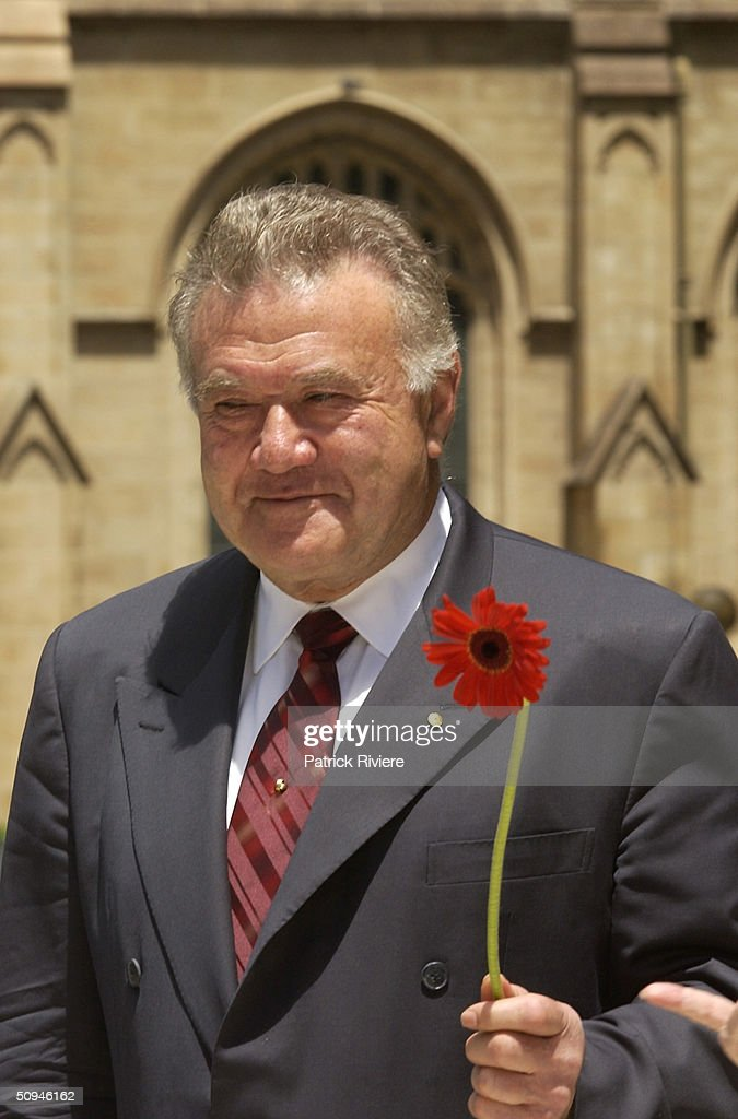 Businessman Richard Pratt of the production company for 'Hair' the musical that makes love not war will be back in Sydney from April 2003. Cast and chorus line sung for peace on the steps of the Sydney Town Hall for the announcement. (Photo by Patrick Riviere/Getty Images).